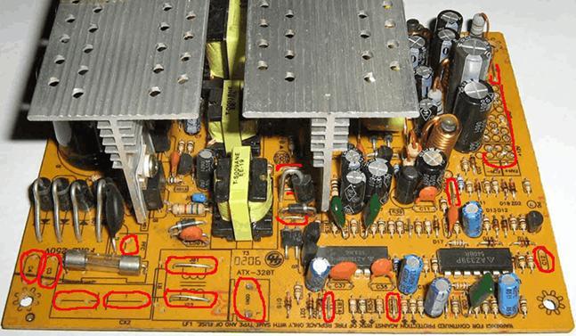Перемычки и пустые разъемы в разобранном блоке питания компьютера